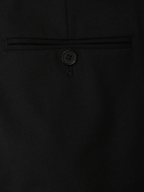 Брюки из шерсти с контрастной отделкой  - Деталь